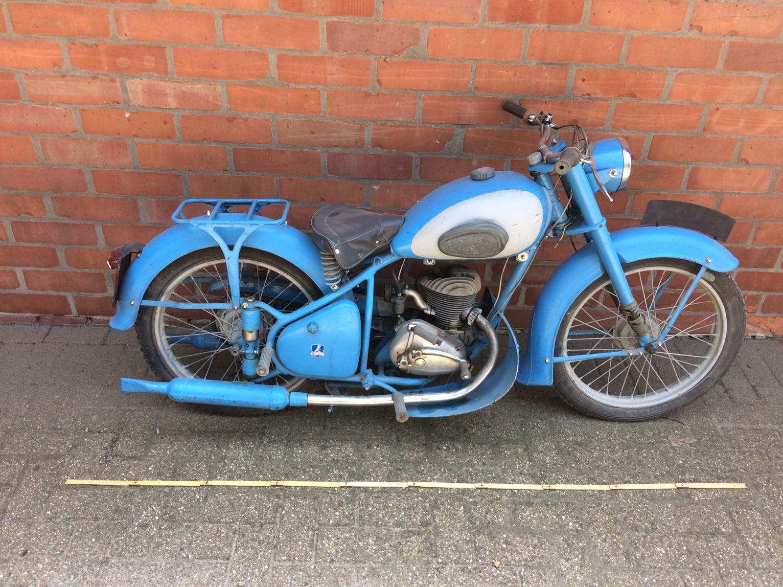 Peugeot 1950's 125c motorcycle with matching helmet. Lot 1009. Estimate £1200-£2400.