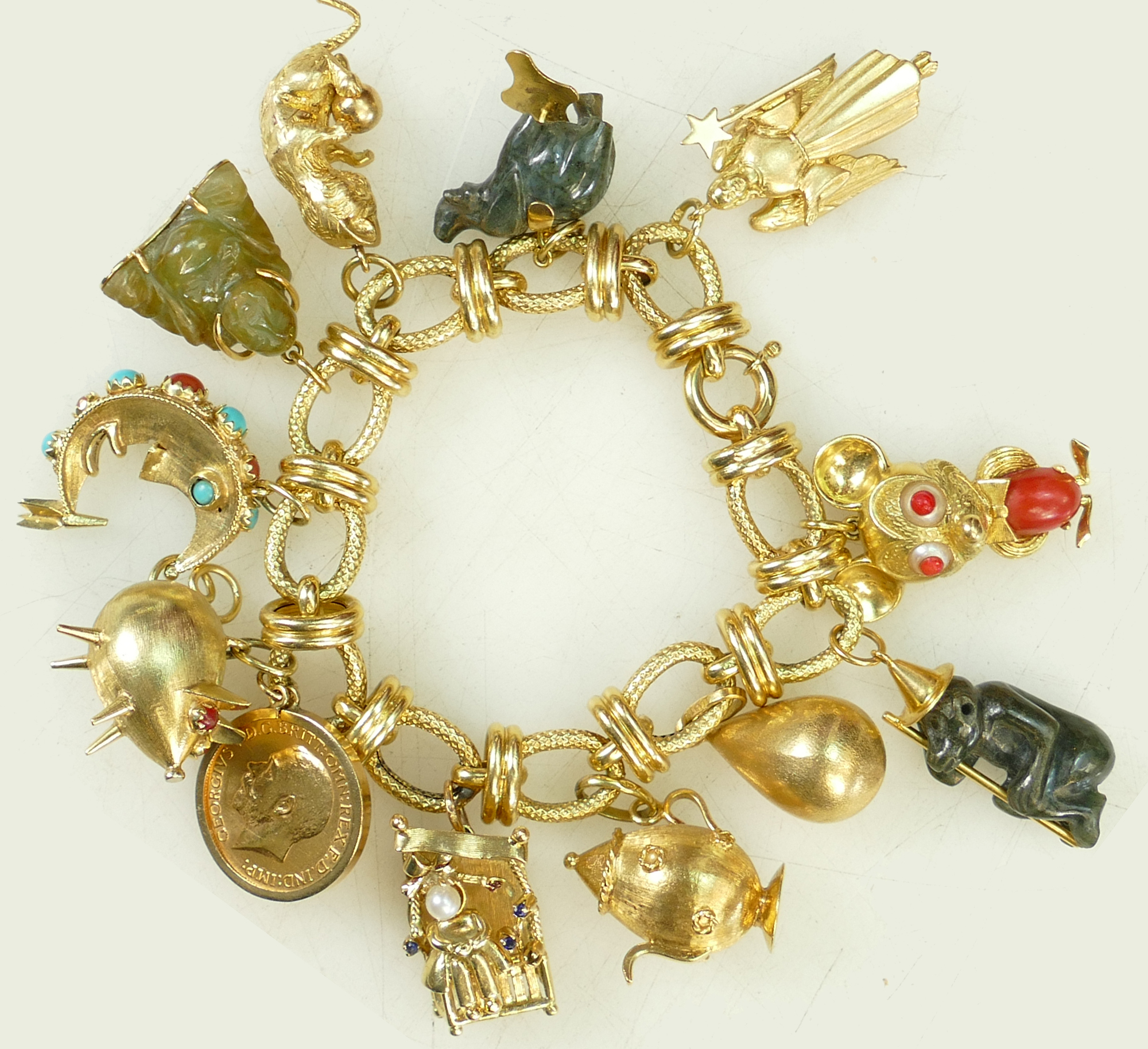 Lot 1923 18ct gold charm bracelet with 12 good quality charms