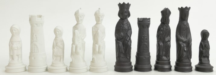 Wedgwood Jasperware Black Basalt and white chess pieces designed by Arnold Machin